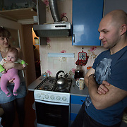 CAPTION: Holding her daughter Valentina close, Nina and her husband Aleksander look ahead to tomorrow, which brings the promise of a new start as Valentina will be receiving corrective surgery for her cleft lip. LOCATION: Volzhskiy, Volgograd Oblast, Russia. INDIVIDUAL(S) PHOTOGRAPHED: Nina Panteleeyeva (mother), Valentina Panteleeyeva (baby) and Aleksander Panteleeyev (father).