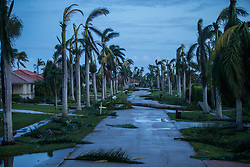 September 11, 2017 - Marco Island, Florida, U.S. - Debris litters the street following Hurricane Irma at Marco Island, Fla., on Monday. Irma made landfall at Marco Island as a category 3 hurricane, according to the National Hurricane Center. (Credit Image: © Loren Elliott/Tampa Bay Times via ZUMA Wire)
