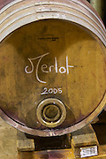 Merlot 2005. Chateau la Condamine Bertrand. Pezenas region. Languedoc. Barrel cellar. Barrel with special metal fitting for red wine barrel fermentation. France. Europe.