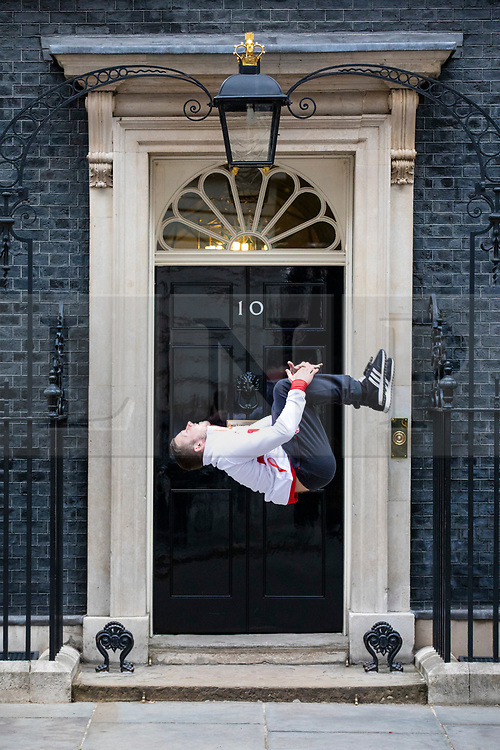 © Licensed to London News Pictures. 04/06/2018. London, UK. Gold medal winning gymnast Dominick Cunningham performs a backflip outside 10 Downing Street. Photo credit: Rob Pinney/LNP