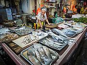05 JUNE 2015 - KUALA LUMPUR, MALAYSIA: A person selling fresh fish in a wet market near the Chinatown section of Kuala Lumpur.     PHOTO BY JACK KURTZ
