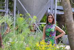 © Licensed to London News Pictures. 20/05/2019. London, UK.  Anita Rani views a floral display. <br /> The Royal Horticultural Society Chelsea Flower Show is an annual garden show held over five days in the grounds of the Royal Hospital Chelsea in West London. The show is open to the public from 21 May until 25 May 2019. Photo credit: Dinendra Haria/LNP