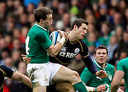 09.02.2013 Edinburgh, Scotland.   Ireland's Criag Gilroy feels the tackle of Scotland's Tim Visser  during the RBS Six Nations Championship match between Scotland and Ireland, from Murrayfield Stadium.