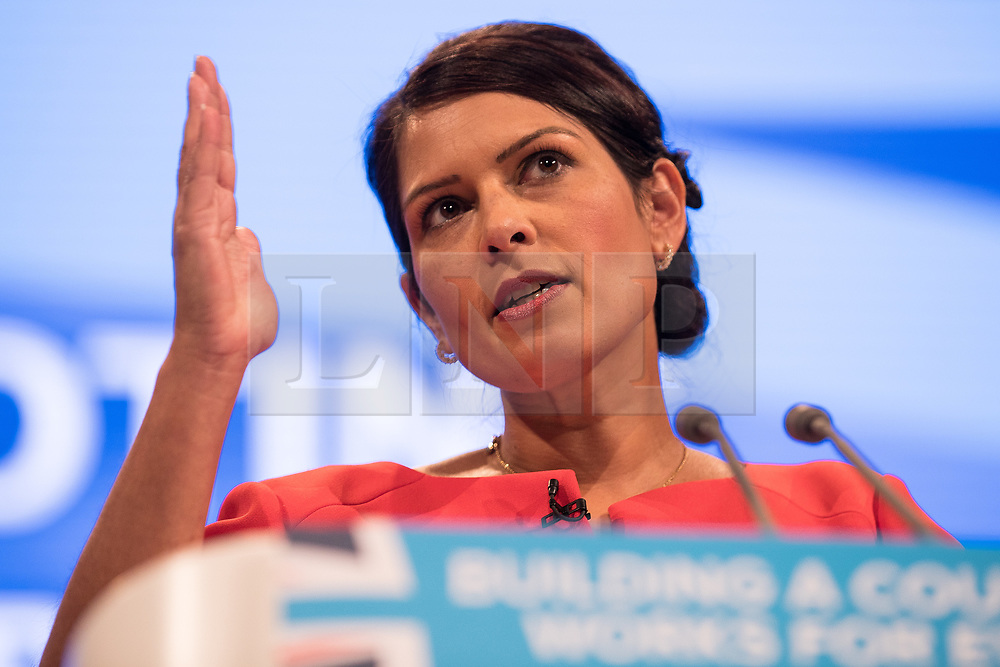 © Licensed to London News Pictures  . 03/10/2017 . Manchester , UK . International development secretary PRITI PATEL delivers her keynote speech , on day three of the Conservative Party Conference at the Manchester Central Convention Centre . Photo credit : Joel Goodman/LNP