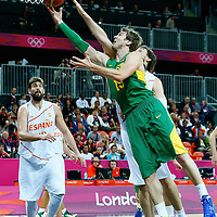 06 August 2012: Brazil Tiago Splitter goes for the layup past Spain Pau Gasol during 88-82 Team Brazil victory over Team Spain, during the men's basketball preliminary, at the Basketball Arena, in London, Great Britain.