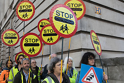 XR Roads Rebellion activists march to the Treasury to protest against the UK government's £27.4bn roads programme on 21st October 2021 in London, United Kingdom. Environmental activists from groups including Extinction Rebellion argue that plans by the government to build new trunk roads are inconsistent with the UK's climate commitments and should be cancelled in the Autumn Spending Review.