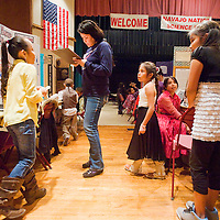 022613       Brian Leddy<br /> Wendy Greyeyes judges students work during the Navajo Nation Science Fair at Red Rock Park Tuesday. Tuesday's event featured elementary school students from all over the Navajo Nation.