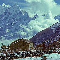 NEPAL, HIMALAYA, Thame Village, a Sherpa settlement in the Khumbu region. 6623-meter Mt. Thamserku & 6685-meter Kangtega (L) bkg.
