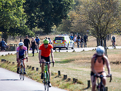 "© Licensed to London News Pictures. 20/09/2020. London, UK. Police patrol Richmond Park in South West London on the first weekend of the ""Rule of Six"" as families enjoy a picnic or walk in the fine weather. Gatherings of over six people have been banned by the Government after a spike in coronavirus cases. Health Minister Matt Hancock has announced that people with coronavirus who don't self-isolate could be fined up to £10,000 and Prime Minister Boris Johnson has said that the UK was heading for a second wave.  Photo credit: Alex Lentati/LNP"