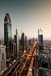 Evening skyline view of skyscrapers along Sheikh Zayed Road in Dubai United Arab Emirates UAE