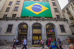 June 15, 2018 - Sao Paulo, Brazil - Vendors show 2018 Russia FIFA World Cup gadgets in the street of Sao Paulo, Brazil, on June 15, 2018. According to Datafolha, 53% of Brazilians have no interest in the tournament. (Credit Image: © Cris Faga/NurPhoto via ZUMA Press)