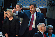 "New Jersey Governor Chris Christie gives a ""thumbs up"" to someone in the House chamber as he waits for Pope Francis to speak to a joint meeting of Congress at the U.S. Capitol in Washington, District of Columbia, U.S., on Thursday, Sept. 24, 2015. The Pope is calling for Americans to do more to fight poverty, curb climate change and help immigrants. His visit runs through Sept. 27, and features stops in Washington, New York and Philadelphia."