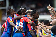Jeffrey Schlupp (15) of Crystal Palace, Patrick van Aanholt (3) of Crystal Palace, celebrates after scoring goal, Aaron Wan-Bissaka (29 ) of Crystal Palace during the Premier League match between Fulham and Crystal Palace at Craven Cottage, London, England on 11 August 2018.
