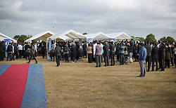 © Licensed to London News Pictures. 04/09/2016. London, UK. Hundreds gather at a traditional Hindu funeral held at Winn's Common Park for five men who drowned at Camber Sands last month.  The five men: Kurushanth Srithavarajah, brothers  Kenigan and Kobi Nathan, Inthushan Sri and Nitharsan Ravi were all friends from London.  They got into difficulty in the sea of Camber Sands on August 24. Photo credit: Peter Macdiarmid/LNP