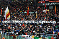 AS Roma fans hold a banner against Antonella Leardi  mother of Ciro Esposito, Napoli's supporters killed before the 2014 Italy cup final. Striscione contro lAntonella Leardi la mamma di Ciro Esposito, tifoso del Napoli ucciso prima della finale di Coppa Italia Napoli Fiorentina del 2014. Lo striscione recita ' Che cosa triste lucri sul funerale con libri e interviste ' <br /> Roma 04-04-2015 Stadio Olimpico, Football Calcio Serie A AS Roma - Napoli Foto Andrea Staccioli / Insidefoto