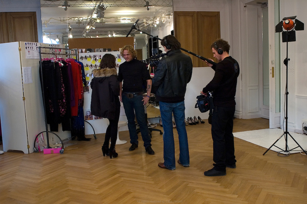 designer Peter Dundas being interviewed by French TV reporter on the last day before the fashion show during the ultimate fittings