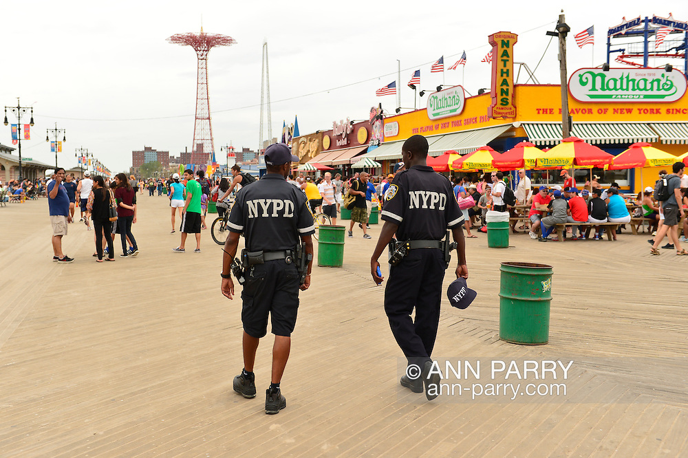 Brooklyn, New York, USA. 10th August 2013. Two Officers of the New York Police Department patrol on foot on the boardwalk at Coney Island, during the 3rd Annual Coney Island History Day celebration.