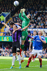 Mark McChrystal (NIR) of Bristol Rovers in action as Trevor Carson (NIR) of Portsmouth punches clear - Photo mandatory by-line: Rogan Thomson/JMP - 07966 386802 - 19/04/2014 - SPORT - FOOTBALL - Fratton Park, Portsmouth - Portsmouth FC v Bristol Rovers - Sky Bet Football League 2.