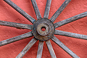 This weathered wooden wheel with turquoise specks leaning against a terracotta colored wall reminds me of Mexico in many ways. Vibrant.