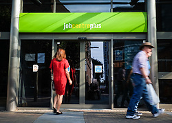 © Licensed to London News Pictures. 14/09/2016. Portsmouth, UK.  A woman enters the Job Centre Plus in Portsmouth this morning following the latest unemployment figures showing that the rate remains unchanged at 4.9% following Brexit. The number of people unemployed fell by 190,000 from the previous year, while the number of people in employment rose 174,000, taking the total to 31.77 million. Photo credit: Rob Arnold/LNP