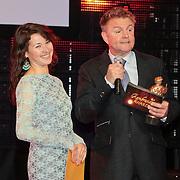 NLD/Amsterdam/20110328 - Uitreking Rembrandt Awards 2011, Birgit Schuurman onthult samen met Rene Mioch de winnaar van de Rembrandt Award