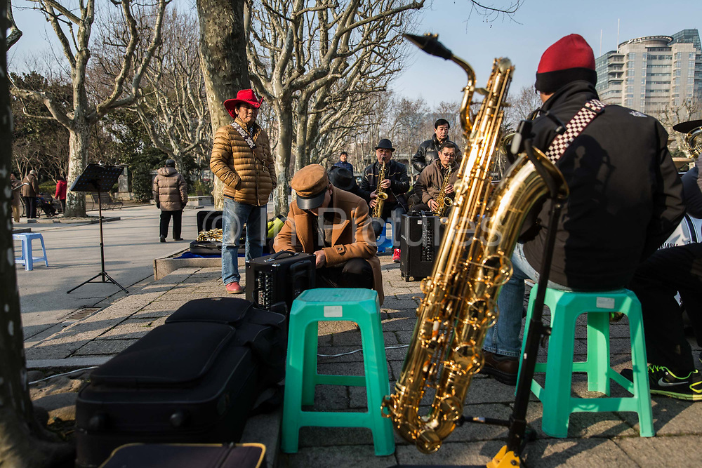 Pensioners play instruments and sing together at Fuxing Park in Shanghai, China, on Feb. 6, 2016.