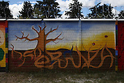 """Mural painted by different organizations and artists on the fence surrounding the Historic National Police Archives reads: """"Hope"""". On July 5, 2005, the historical archives of the now dissolved National Police were found in an abandoned arms depot in the outskirts of Guatemala City. The discovery of these millions of documents, which were allegedly lost after the 1996 Peace Accords, provide important evidence in the search for the thousands of people who were detained and subsequently disappeared by State security forces during the internal armed conflict (1960-1996). Guatemala City, Guatemala. December 13, 2011."""