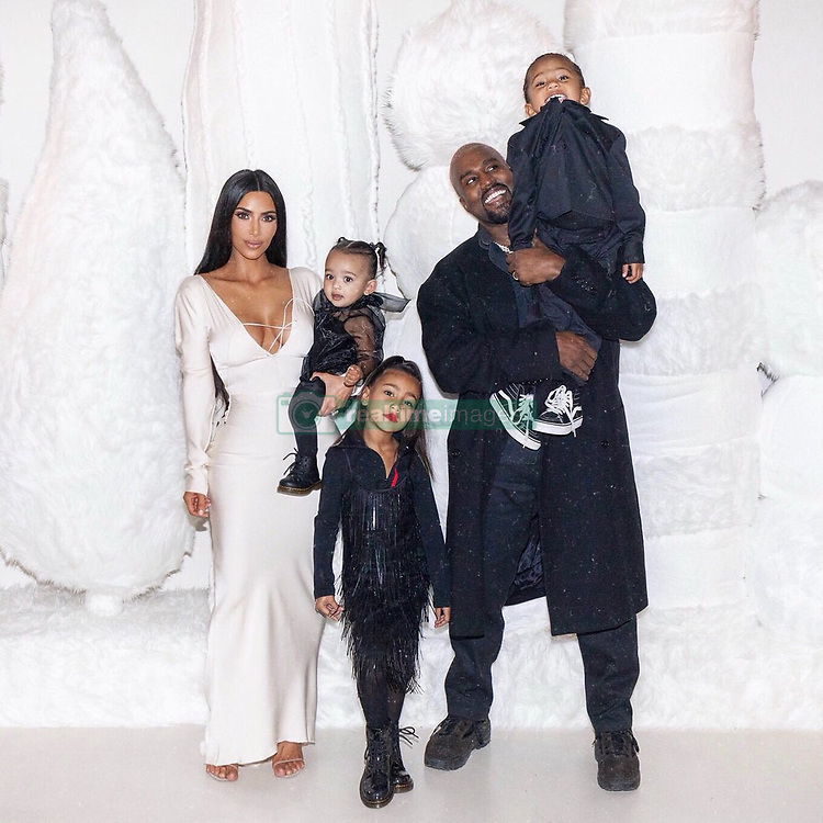 """Kim Kardashian releases a photo on Twitter with the following caption: """"""""Merry Christmas 🎄"""""""". Photo Credit: Twitter *** No USA Distribution *** For Editorial Use Only *** Not to be Published in Books or Photo Books ***  Please note: Fees charged by the agency are for the agency's services only, and do not, nor are they intended to, convey to the user any ownership of Copyright or License in the material. The agency does not claim any ownership including but not limited to Copyright or License in the attached material. By publishing this material you expressly agree to indemnify and to hold the agency and its directors, shareholders and employees harmless from any loss, claims, damages, demands, expenses (including legal fees), or any causes of action or allegation against the agency arising out of or connected in any way with publication of the material."""