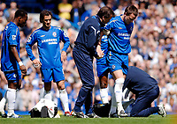 Photo: Daniel Hambury.<br />Chelsea v Manchester United. The Barclays Premiership. 29/04/2006.<br />Chelsea's John Terry leaves the pitch for treatment to a foot injury.