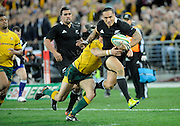 Hosea Gear trys to bust the tackle, Rugby Championship. Australia v All Blacks at ANZ Stadium, Sydney, New Zealand. Saturday 18 August 2012. New Zealand. Photo: Richard Hood/photosport.co.nz
