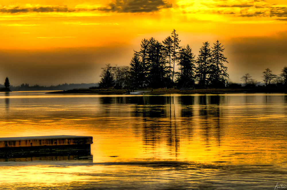 A Island in the middle of a lake at sunset, mist rising in the background, a dock in the forground, Very Yellow sky.