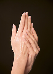 Close up of a woman's hands applying beauty hand scrub