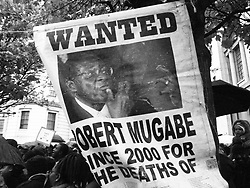 November 18, 2017 - London, England, United Kingdom - Protesters demonstrate outside the Embassy of Zimbabwe in London to call on the leader of the country Robert Mugabe to resign on November 18, 2017 in London, England. 93-year-old Mr Mugabe has been under house arrest following a military takeover in Zimbabwe with generals urging him to resign. (Credit Image: © Jay Shaw Baker/NurPhoto via ZUMA Press)