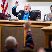 Gallup mayor Jackie McKinney asks for a show of hands from the audience in a debate about a liquor license transfer during the Gallup city council meeting at city hall in Gallup Tuesday.
