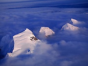 Aerial view of cloud bank enveloping peaks of the Alaska Range on the west side of the Great Gorge of the Ruth Glacier, Denali National Park, Alaska.