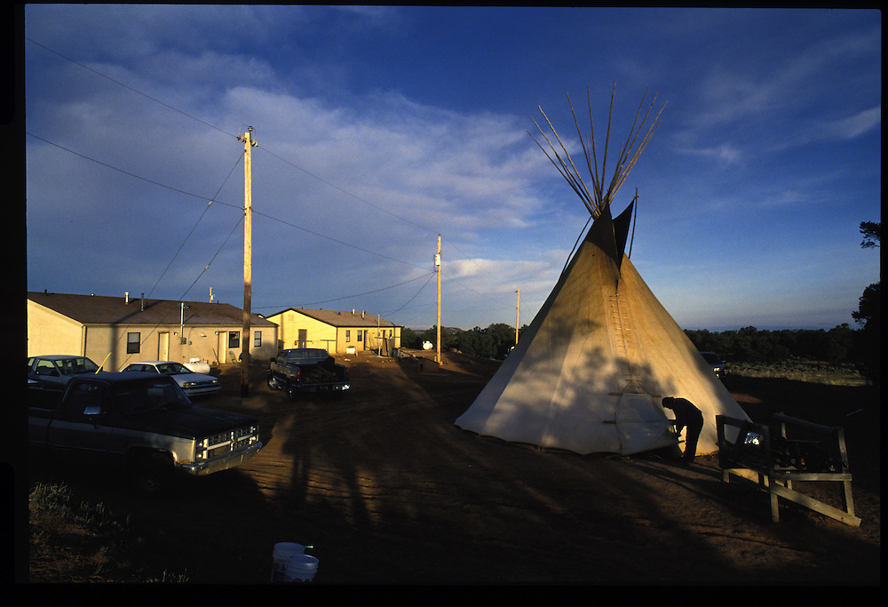 """After a night of marathon prayer, the sun rises on the tepee of a """"roadman"""" next to the Harvey compound complex.  Tsaile, Arizona."""