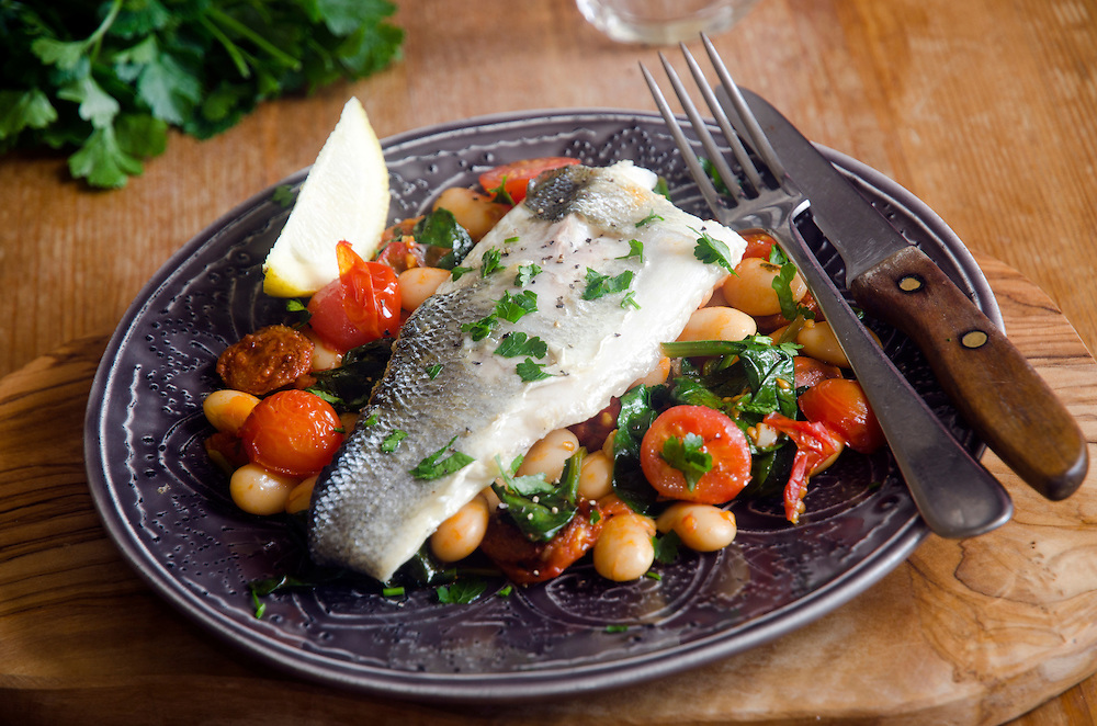 Sea bass with chorizo, tomatoes and butter beans