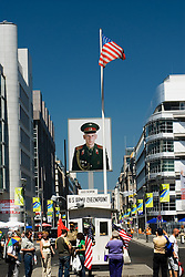 Famous Checkpoint Charlie in Berlin where border crossing through  Berlin Wall was once located.