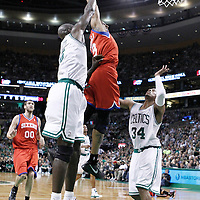 21 May 2012: Philadelphia Sixers small forward Andre Iguodala (9) dunks the ball over Boston Celtics small forward Paul Pierce (34) during the Boston Celtics 101-85 victory over the Philadelphia Sixer, in Game 5 of the Eastern Conference semifinals playoff series, at the TD Banknorth Garden, Boston, Massachusetts, USA.