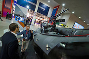 Military 'ribs' rub shoulders with sandwich bars - The DSEI (Defence and Security Equipment International) exhibition at the Excel Centre, Docklands, London UK 15 Sept 2015
