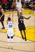 Golden State Warriors guard Stephen Curry (30) shoots a jumper over Houston Rockets guard Lou Williams (12) at Oracle Arena in Oakland, Calif., on March 31, 2017. (Stan Olszewski/Special to S.F. Examiner)