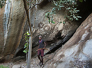 Cave with ancient Hadza rock paintings. Hunting in the Gideru mountains with Kaunda and January, two Hadza hunters.
