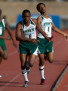 Rodney Van of Long Beach Poly High (Calif.) takes handoff from Julian Sylvie on the second leg of the Championship of America Boys 4 x 400-meter relay in the 110th Penn Relays at  Franklin Field on Saturday, April 24, 2004 in Philadelphia. Winslow of New Jersey won in 3:13.71 and Poly was second in 3:14.18.