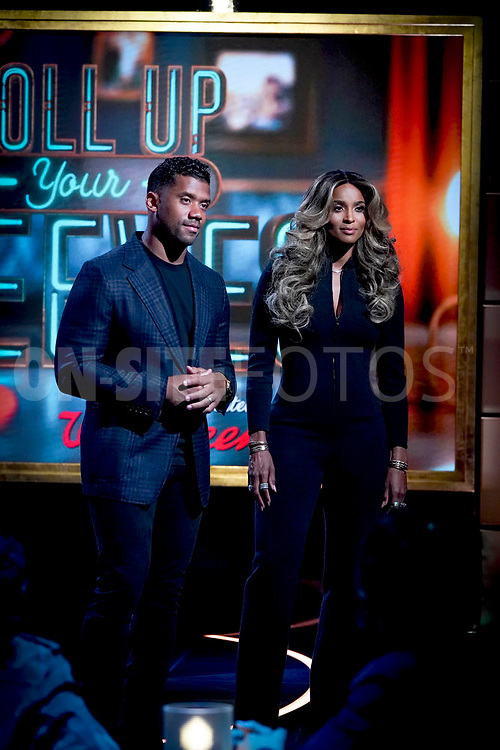 ROLL UP YOUR SLEEVES: PRESENTED BY WALGREENS -- Pictured: (l-r) Russell Wilson, Ciara -- (Photo by: Chris Haston/NBC)