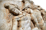 Detail of a  Roman Sebasteion relief sculpture of Achilles and a dying Amazon, Aphrodisias Museum, Aphrodisias, Turkey.       Against a white background.<br /> <br /> Achilles supports the dying Amazon queen Penthesilea whom he has mortally wounded. Her double headed axe slips from her hands. The queen had come to fight against the Greeks in the Trojan war and Achilles fell in love with her. .<br /> <br /> If you prefer to buy from our ALAMY STOCK LIBRARY page at https://www.alamy.com/portfolio/paul-williams-funkystock/greco-roman-sculptures.html . Type -    Aphrodisias     - into LOWER SEARCH WITHIN GALLERY box - Refine search by adding a subject, place, background colour, museum etc.<br /> <br /> Visit our ROMAN WORLD PHOTO COLLECTIONS for more photos to download or buy as wall art prints https://funkystock.photoshelter.com/gallery-collection/The-Romans-Art-Artefacts-Antiquities-Historic-Sites-Pictures-Images/C0000r2uLJJo9_s0