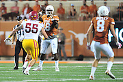 AUSTIN, TX - OCTOBER 18:  Tyrone Swoopes #18 of the Texas Longhorns drops back to pass against the Iowa State Cyclones on October 18, 2014 at Darrell K Royal-Texas Memorial Stadium in Austin, Texas.  (Photo by Cooper Neill/Getty Images) *** Local Caption *** Tyrone Swoopes
