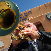 053014       Adron Gardner/Independent<br /> <br /> Gallup Police Department Chaplain Mike Kleeberger plays Taps during the Fallen Officer's Memorial Service at the Larry Brian Mitchell Recreation Center in Gallup Friday.
