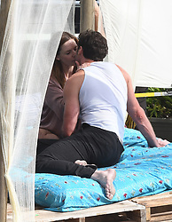** PREMIUM EXCLUSIVE RATES APPLY ** Actor Hugh Jackman is seen kissing Swedish actress Rebecca Ferguson on a bed during filming in Miami. The mood on set was light as the actors were seen laughing between takes and embracing after the final scene wrapped. 05 Jan 2020 Pictured: Hugh Jackman; Rebecca Ferguson. Photo credit: MEGA TheMegaAgency.com +1 888 505 6342