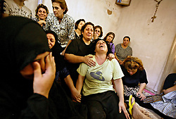 Family members of victims of the UN Bombing are seen mourning the loss of a loved one in Baghdad, Iraq on Aug. 20, 2003.