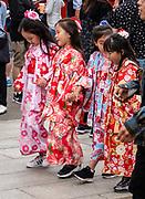Japanese girls in kimonos in Asakusa district, Tokyo, Japan.